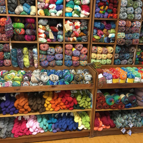 Yarn Bundles On Shelves At Knitting Criations In Somers CT.