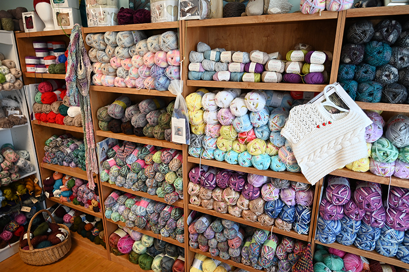 an image of yarn on the shelves of a knitting store in Connecticut