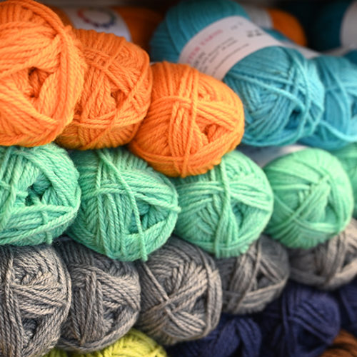 A Close Up Image Of Yarn On The Shelf Of A Knitting Store In Connecticut